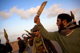 5b34f-libya-conflict-men-swords-leving