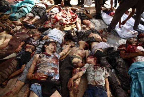 A picture taken on August 16, 2015 shows dead bodies laying on the ground following air strikes by Syrian government forces on a marketplace in the rebel-held area of Douma, east of the capital Damascus. At least 70 people were killed and 200 people were injured, with the death toll -most of them civilians- likely to rise as many of the wounded were in serious condition, the Syrian Observatory for Human Rights said. AFP PHOTO / ABD DOUMANYABD DOUMANY/AFP/Getty Images