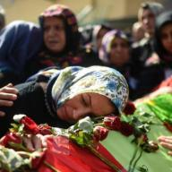 Kurdish relatives mourn near the coffin of a victim of the twin bombings in Ankara