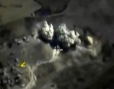 Shows an explosion after airstrikes carried out by Russian air force on what Russia says was an underground explosives warehouse in Raqqa.