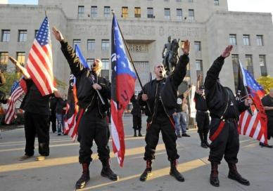Nazi's salute speaker at a neo-Nazi rally in Kansas City, Missouri.