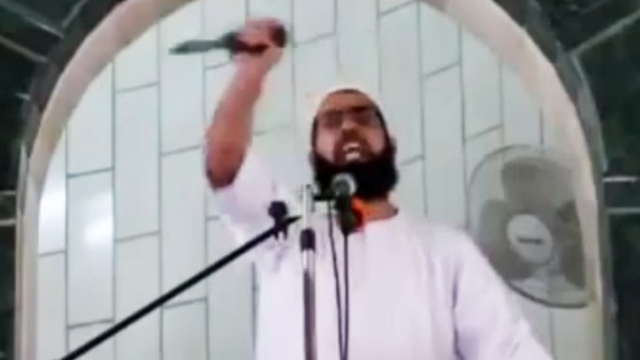 Muhammad Sallah brandishes a knife during a Friday sermon at al-Abrar mosque in the Gaza Strip town of Rafah on October 9 from YouTube