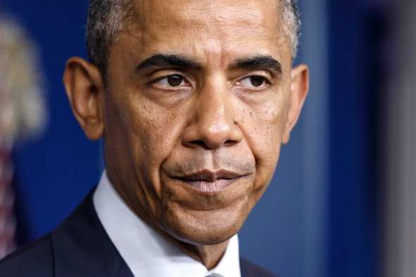 """FILE - This July 18, 2014, file photo shows President Barack Obama speaking about the situation in Ukraine in the Brady Press Briefing Room of the White House in Washington. Obama stated the obvious: """"We live in a complex world and at a challenging time."""" The confluence of swiftly moving overseas matters comes at a time when the American public's views on Obama's foreign policy have been souring, turning what was once seen as his strength into a potential liability. (AP Photo/J. Scott Applewhite)"""