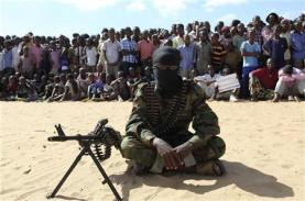 A member of Somalia's al Shabaab militant group sits during a public demonstration to announce their integration with al Qaeda, in Elasha, south of the capital Mogadishu